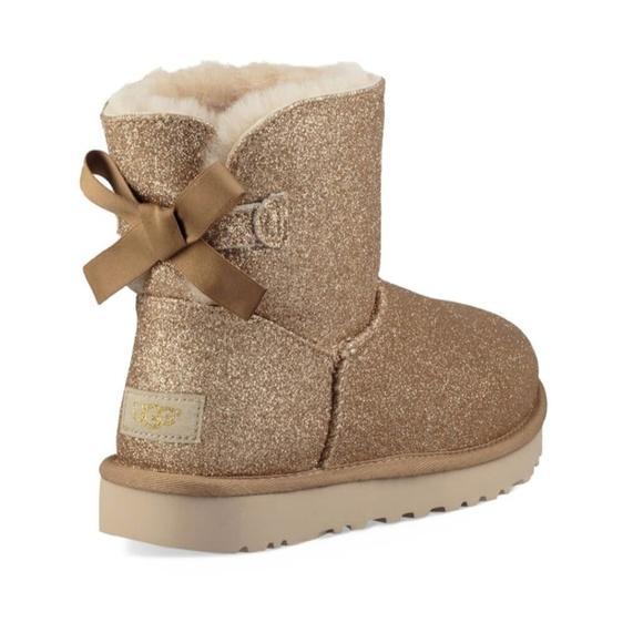 1d96ceca1 UGG Mini Bailey Bow Gold Sparkle Boots Glitter NEW. NWT. UGG.  M_5c4903374ab633be169c39d3. M_5c490337aa87707a462e1ac3.  M_5c4903380cb5aaf70fbec62b